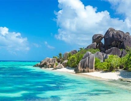 Exotic destination in Seychelles - Anse Source d'Argent - beautiful beach on tropical island La Digue